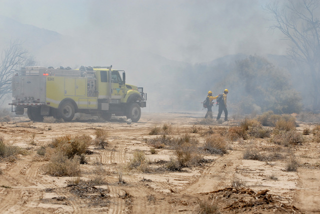 Horace Langford Jr./Pahrump Valley Times A U.S. Bureau of Land Management crew is seen battling a wildfire in the Pahrump area as seen in this 2014 file photo. Though the threat of fire has been r ...
