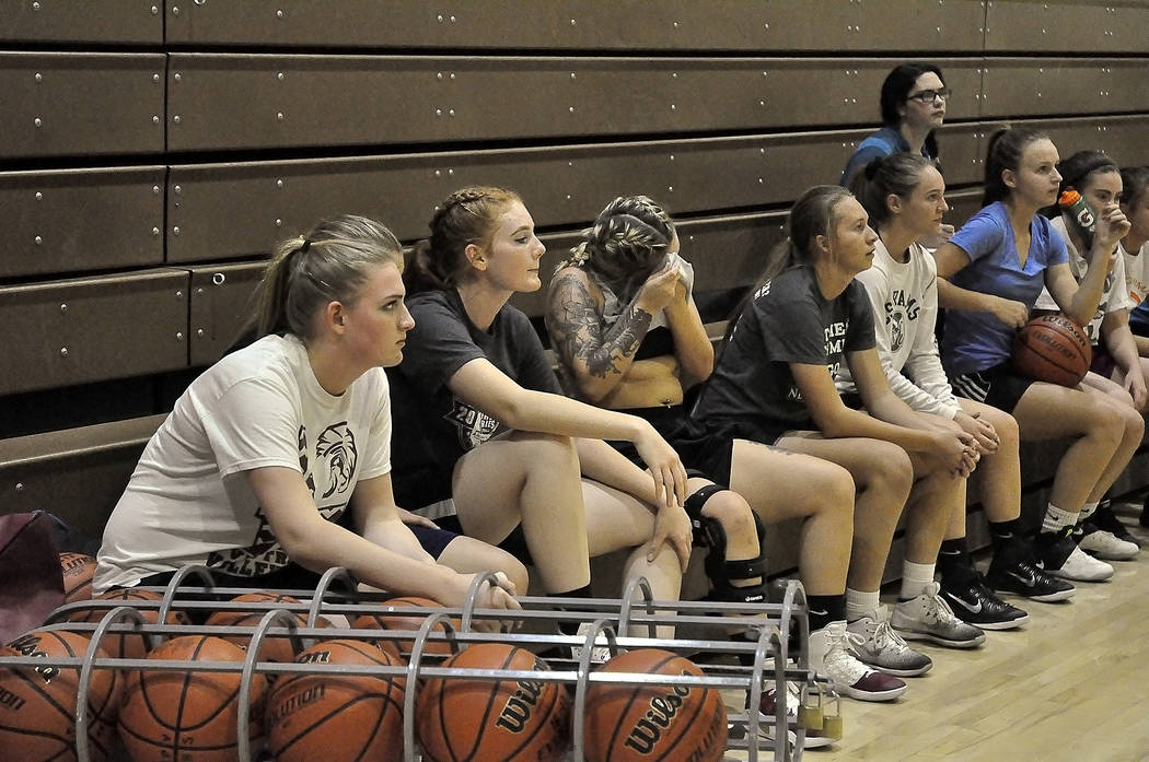 Horace Langford Jr./Pahrump Valley Times -  Trojans girls varsity basketball listens to instructions before practice. Hopkins took the team to the playoffs last year as the third seed team. The te ...