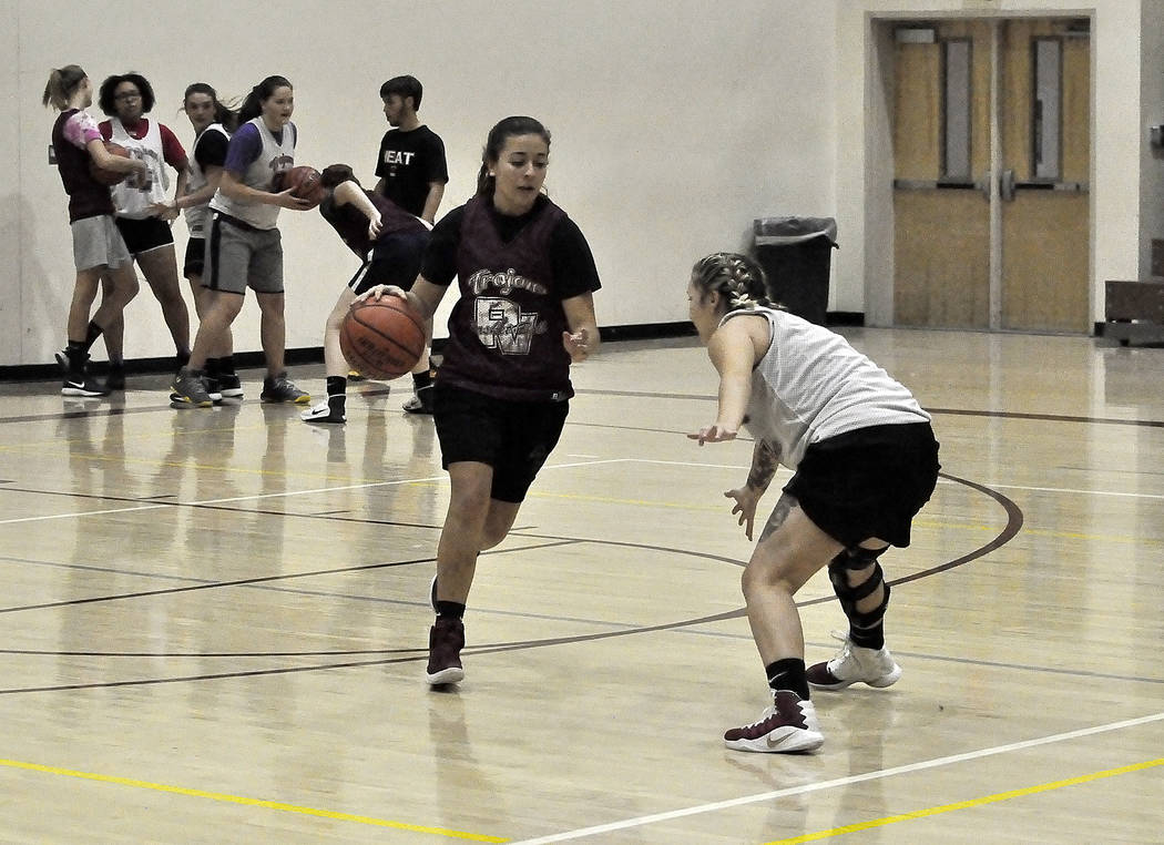 Horace Langford Jr./Pahrump Valley Times -  Virginia Weir takes the ball down court as Sabin Chaidez guards her in a ball handling drill during practice on Tuesday. The girls first game is at home ...