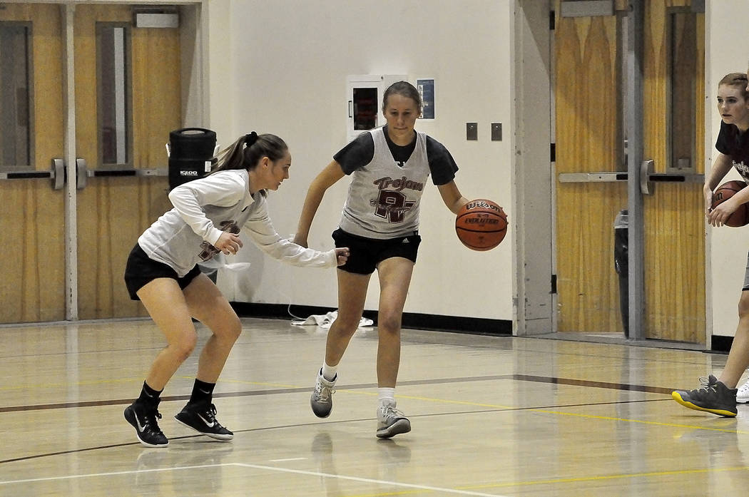 Horace Langford Jr./Pahrump Valley Times -  Junior Jackie Stobbe tries to guard senior Aliyvia Briscoe at practice. Trojans lost a lot of seniors but return girls with experience.
