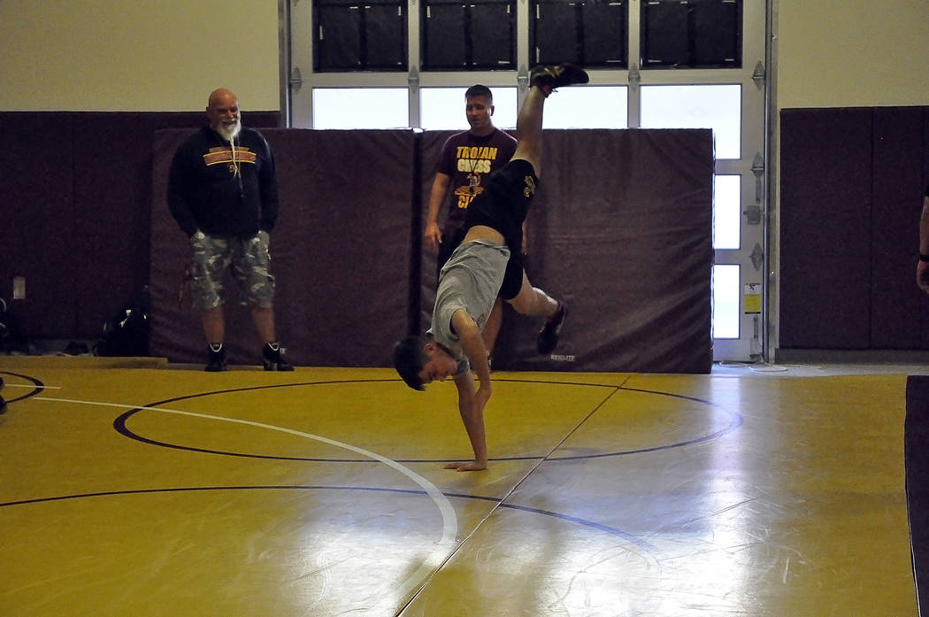 Horace Langford Jr./Pahrump Valley Times -  Dylan Grossell shows his graceful moves on the wrestling match as coach Craig Rieger (right) and coach Fred Schmidt look on. Grossell will have to wrest ...