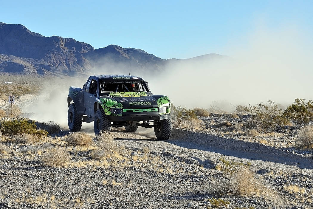 Horace Langford Jr./Pahrump Valley Times -  A trick truck speeds into pit one of the Pahrump 250 last year. Part of the attraction of this race for the racers is the intensity of the course, which ...