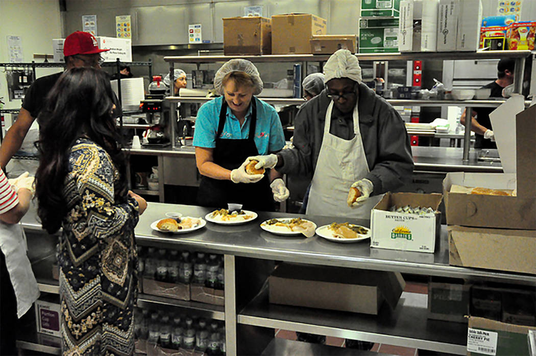 Horace Langford Jr. / Pahrump Valley Times  In 2016, nearly 200 volunteers helped to serve up 891 meals during the free Thanksgiving Community Dinner at the NyE Communities Coalition. That number  ...