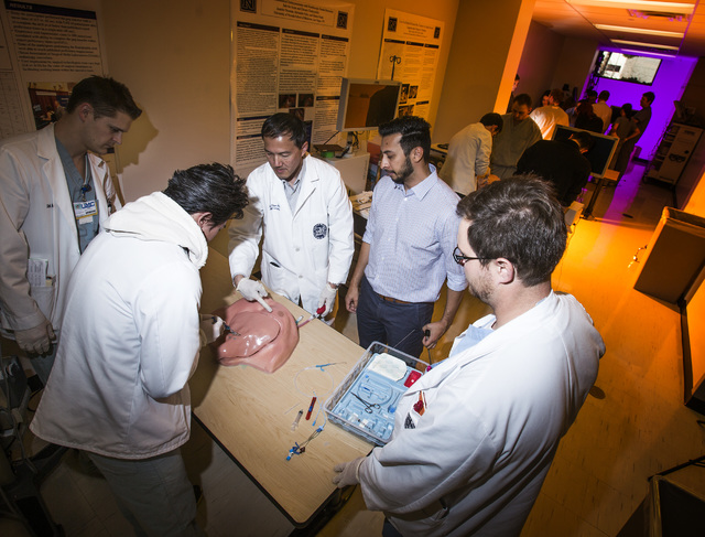 Jeff Scheid/Las Vegas Review-Journal Dr. Gary Shen, an associate professor of surgery, center, advises medical students at the University of Nevada School of Medicine Clinical Simulation Center as ...