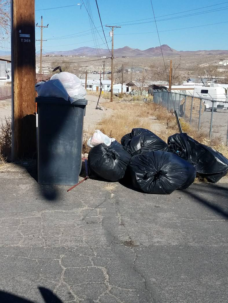 Trash piles up in historic Nye County town