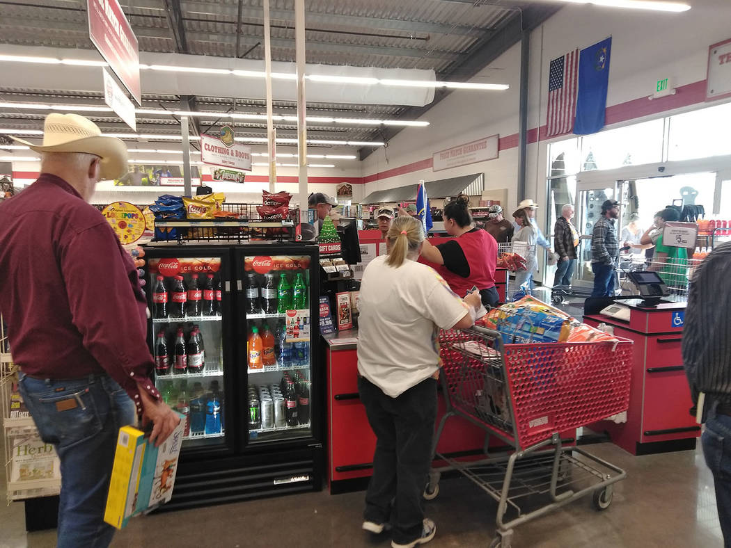 Selwyn Harris/Pahrump Valley Times  There was no shortage of customers checking out this month when officials at Pahrump's Tractor Supply Company opened for business. Manager Mark Slingerland ma ...