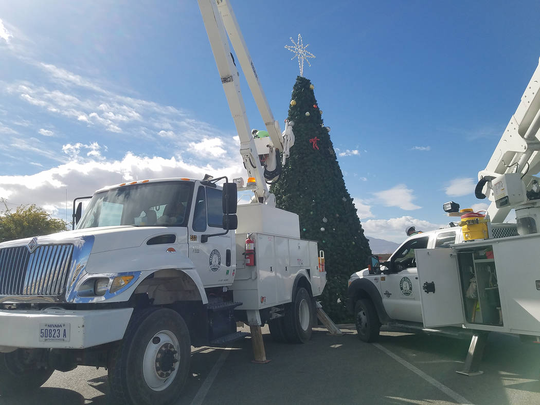 David Jacobs/Pahrump Valley Times Crews from Valley Electric Association are shown in this Nov. 17 preparing the town Christmas tree for a lighting planned for Nov. 25 outside the Pahrump Nugget h ...