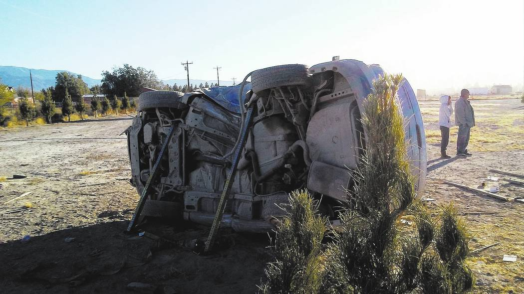 Selwyn Harris/Pahrump Valley Times  Both car and driver sustained significant damage and injuries after a Sunday morning single-vehicle rollover crash a short distance from the brothels along sout ...