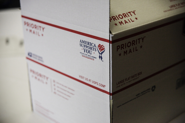 A flat-rate box waits to be packaged by the Blue Star Mothers of Henderson and Boulder City as part of a Christmas care package for deployed troops Tuesday, Nov. 19, 2013 at the Henderson Conventi ...
