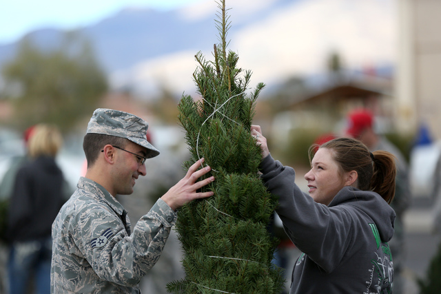 Senior Airman Adam Low and wife Bethany decide on a Christmas tree  during the annual Christmas SPIRIT Foundation's Trees for Troops Program at Nellis Air Force Base on Friday, December 2, 2016. ...