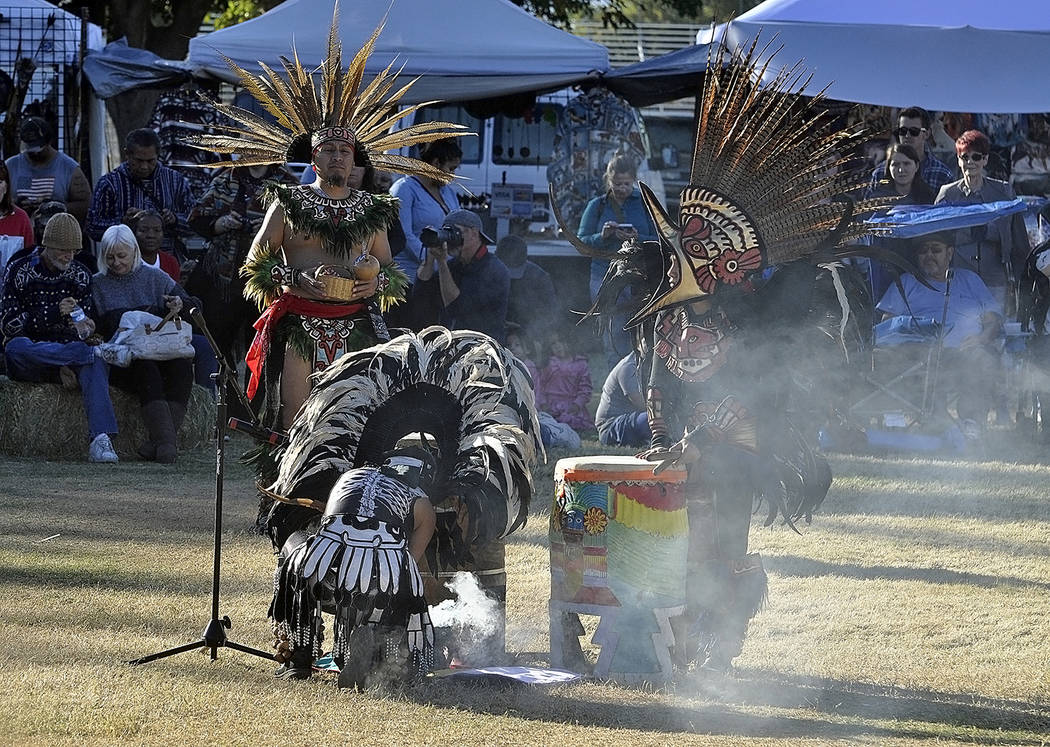 """Horace Langford Jr./Pahrump Valley Times  Aztec dancer perform what's known as a purification ritual after Saturday's Powwow """"Grand Entry."""" Native American crafts, food, culture and even d ..."""