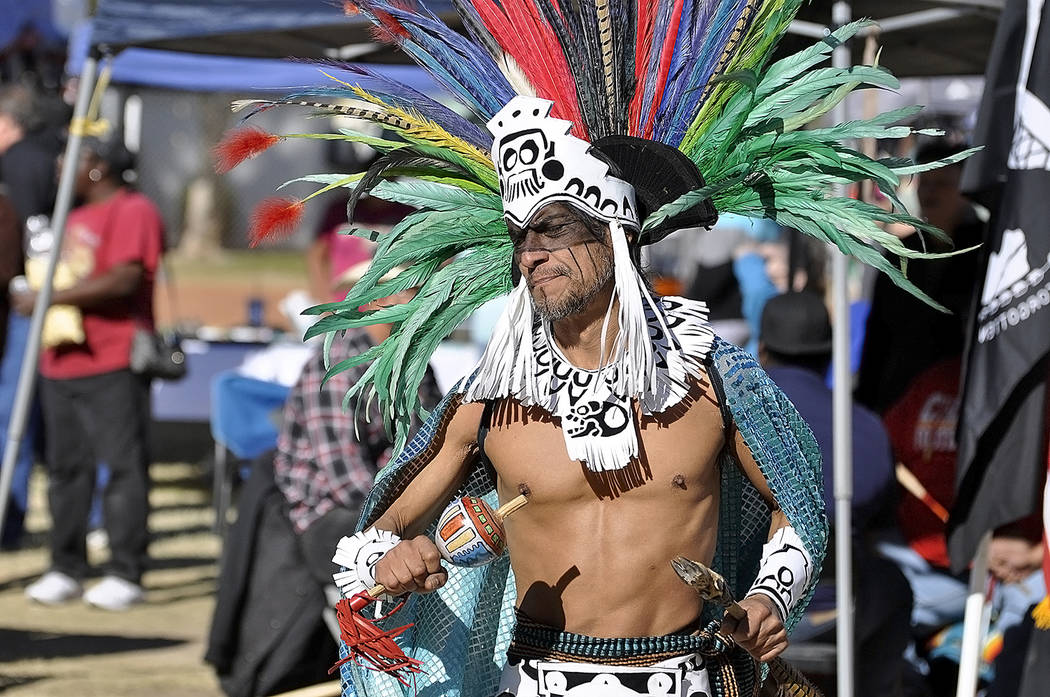Horace Langford Jr./Pahrump Valley Times  An Aztec dancer performs an ancient ritual dance during the Inter-tribal dance portion of the 2017 Pahrump Social Powwow on Saturday. Gourd dancers along  ...