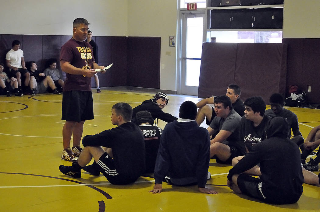 Horace Langford Jr./Pahrump Valley Times Coach Craig Rieger addresses the wrestling team during practice. Trojans are attempting to go back to the state championships, just as they did in the 2014 ...