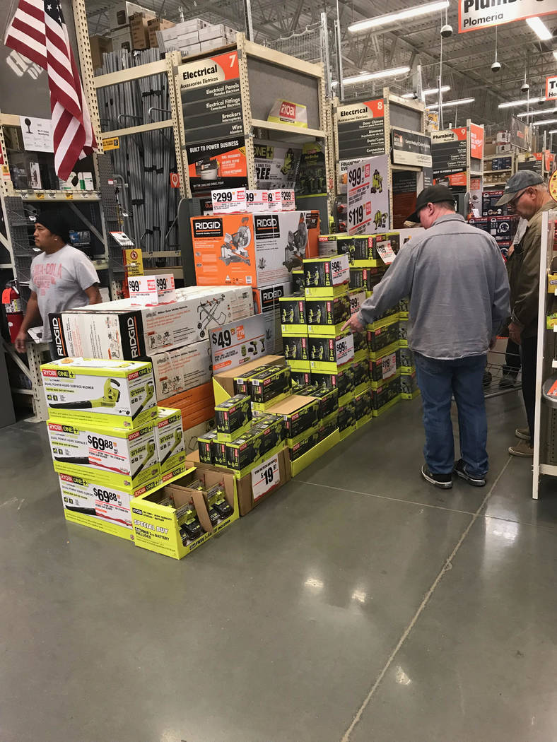 Jeffrey Meehan/Pahrump Valley Times Shoppers check for deals at the Home Depot in Pahrump at 301 N. Highway 160. Shoppers bought up the store's large toolboxes in minutes after the doors opened on ...