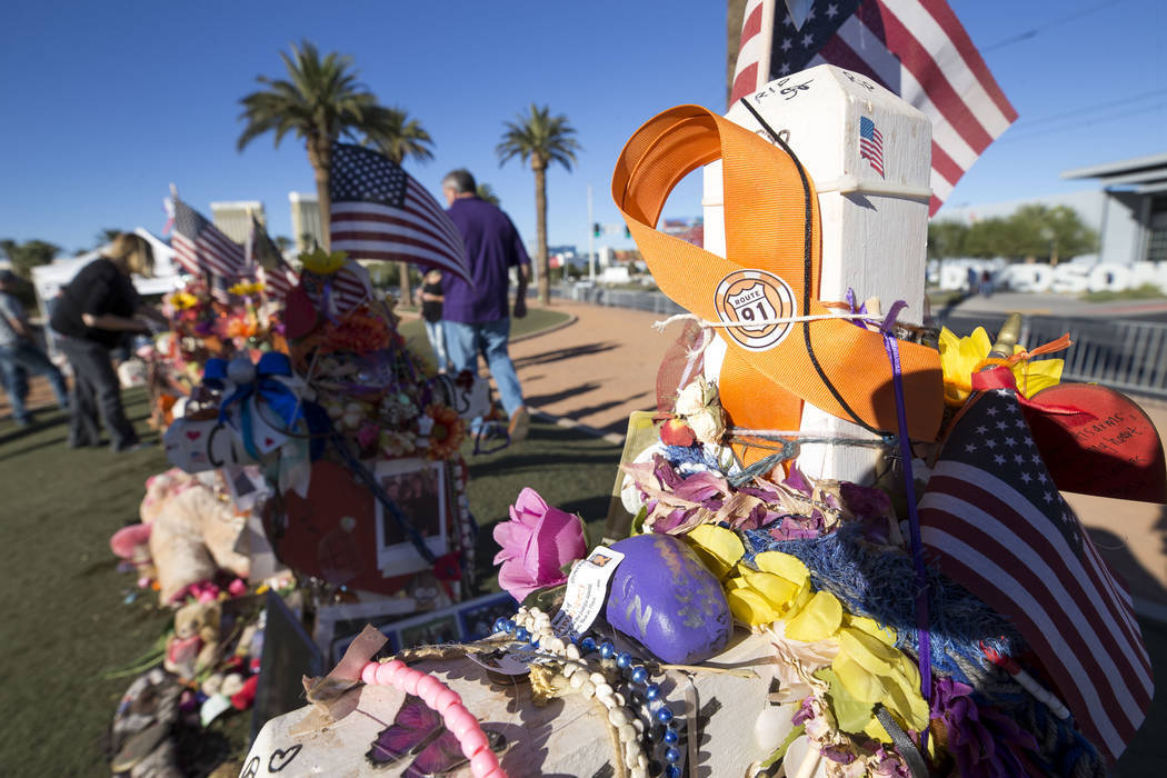 Richard Brian/Las Vegas Review-Journal  The crosses and mementos left behind by visitors at a memorial for Route 91 Harvest shooting victims at the Welcome to Fabulous Las Vegas sign, Thursday, No ...