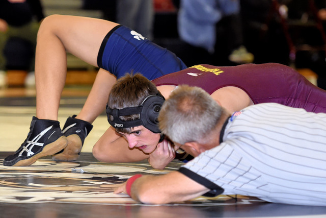 Peter Davis / Special to the Pahrump Valley Times Tristan Maughan takes his opponent down on Saturday at the Spring Valley Duals. The Trojans didn't win any matches out of four, but were close and ...