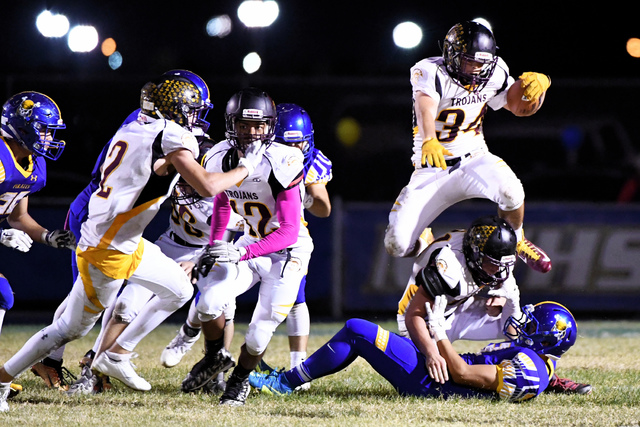 Nico Velazquez was the highlight of the game for Pahrump, seen above as he hurdles a Moapa player for extra yards. Velazquez opened the third quarter with a 99-yard kickoff return for the first po ...