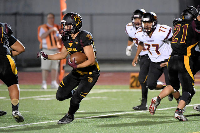 Peter Davis / special to the Pahrump Valley Times  Nico Velasquez runs unopposed. He had a terrific opener, running a kickoff return 99 yards at the end of the first half.