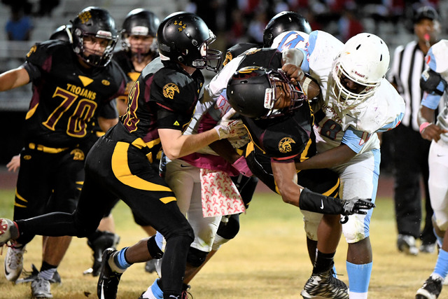 Nickolas Redmond carries the ball last Friday during the Trojans fifth win of the season.  Peter Davis * / Special to the Pahrump Valley Times