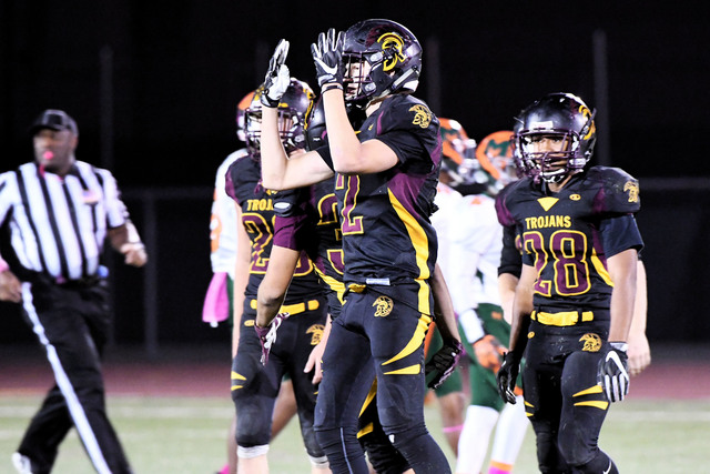 Peter Davis / Special to the Pahrump Valley Times Cory Bergan celebrates after one of his four interceptions in the game. Bergans efforts was key in allowing the Trojans offense to get into a rythm.