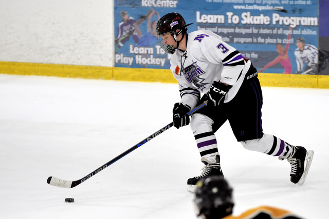 Ben McDowell skates with the puck in Las Vegas for his team, the Storm, in an ice hockey tournament at the Las Vegas Ice Center over the weekend. He has been playing ice hockey for four years. He  ...