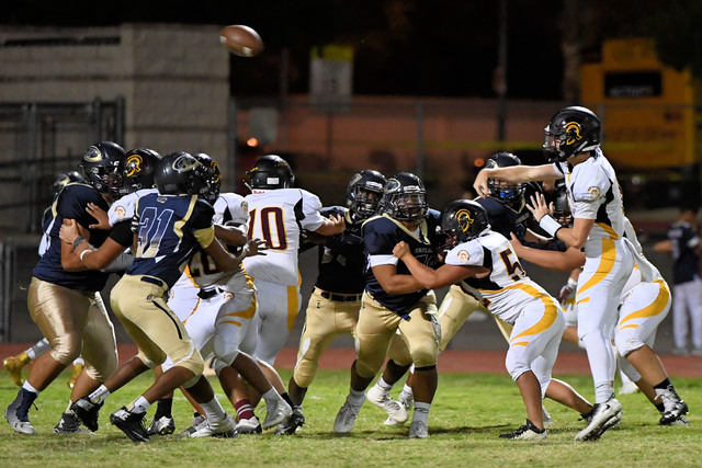 Parker Hart passes the ball against Cheyenne. The Trojans need to have four solid quarters of football to beat Sunrise Mountain.  Peter Davis/Special to the Pahrump Valley Times