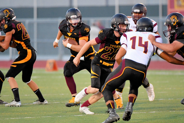 Peter Davis / special to the Pahrump Valley Times  Senior quarterback Parker Hart runs the ball. Hart threw a 49-yard TD pass to Nico Velasquez for six points.