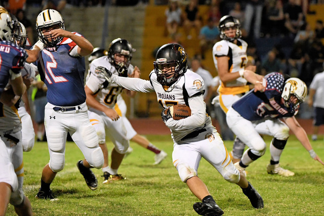 Peter Davis / Special to the Pahrump Valley Times Senior receiver Jesse Dillon looks for open ground against Boulder City last Friday night.
