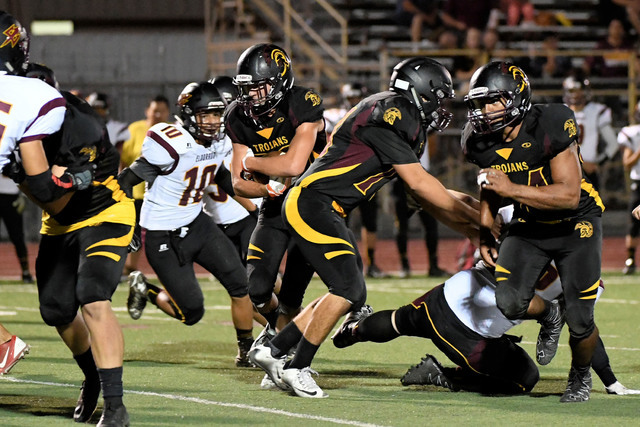 Peter Davis / Special to the Pahrump Valley Times  Riley Sutton looks for a hole during the Eldorado game last Friday. The Trojans beat the Sundevils on the ground 38-10.