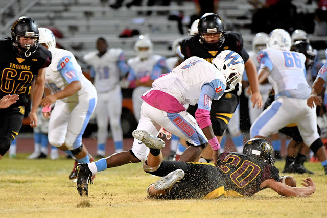 Riley Sutton goes for the ball against Western in a fumble recovery. The Warriors had a few turnovers that prevented them from winning the game.  Peter Davis * / Special to the Pahrump Valley Times