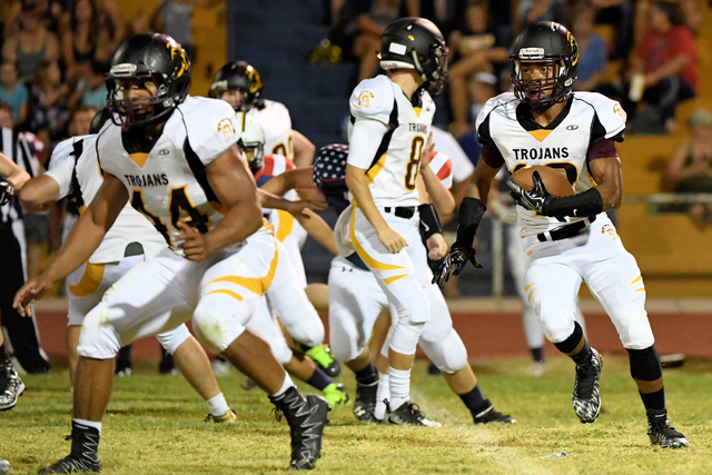 Peter Davis / Special to the Pahrump Valley Times  Nickolas Redmond carries the ball in  the 35-6 victory the Eagles.