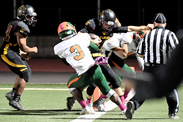 Peter Davis / special to the Pahrump Valley Times Drew Walker is stopped on the one-yard line after a 35-yard carry in the fourth quarter. On the next play Aaron Fuentes scored the touchdown for P ...