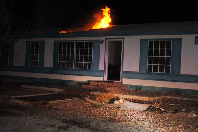 A Pahrump man was arrested after his home caught on fire and fire officials discovered an alleged marijuana grow house which had nearly 200 plants inside.  Special to the Pahrump Valley Times