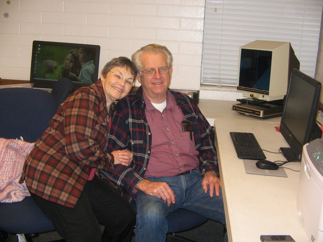 Linna and Andy Barnum share a family moment at the Pahrump FamilySearch Center where they volunteer while researching their own family roots. The center is located at 921 Wilson Road in the buildi ...