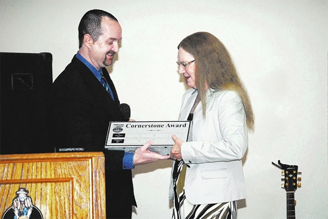 Former publisher Marie Wujek accepts the Pahrump Valley Chamber of Commerce's Cornerstone Award on behalf of the Pahrump Valley Times during the 2014 Installation Dinner Awards Ceremony. The ann ...