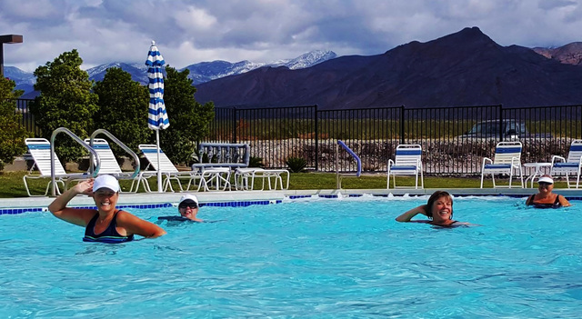 Bathers brave cold temperatures while enjoying the pool at Wine Ridge RV Resort & Cottages with snow-clad mountains in the backdrop. The resort is hosting its inaugural Polar Bear Plunge on Fr ...