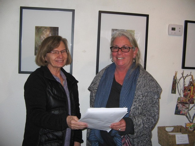 Mary Burke King and Amy Noel look over the schedule of the second annual Celebration of the Desert through Arts and Culture workshop on Saturday, Feb. 18. The daylong event will be held in the flo ...