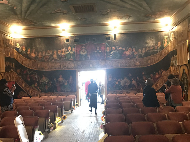 People linger inside the Amargosa Opera House following the celebration of life for Marta Becket on Feb. 10. The state of California is threatening to revoke the property's nonprofit status and  ...