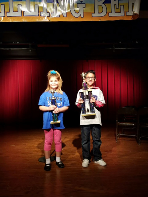 J.G. Johnson Elementary's Kiana Reynolds, left, and Floyd Elementary's Samson Wagner hold their respective trophies after finishing tops in the Nye County School District K-2 Spelling Bee last ...