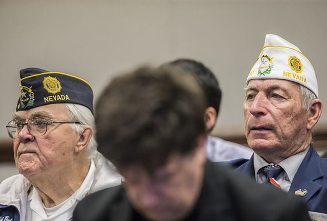 Navy veteran Mitch Roach, right, listens to testimony during a Senate Government Affairs Committee meeting on the third day of the Nevada Legislative session on Feb. 8 in Carson City.   Benjamin H ...