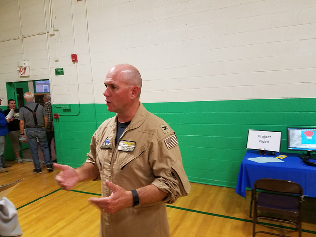Capt. David Halloran, commanding officer of Naval Air Station Fallon, speaks to a crowd member in Gabbs on Oct. 7. Nye County recently received cooperating agency status for a proposed expansion o ...