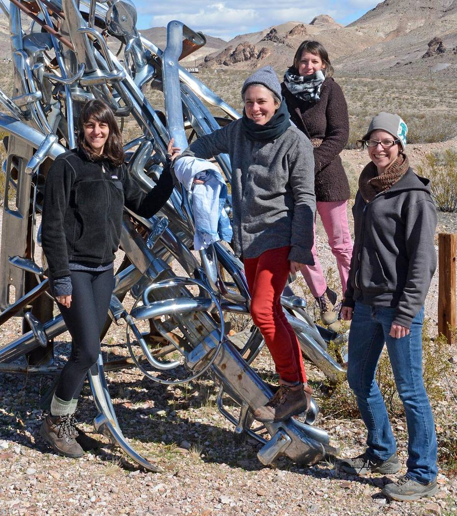 "Megan Berner, Jennifer Meridian, Jill Baker, and Nicole Donnelly, from left, gathered around Albert Szukalski's ""Desert Flower"" sculpture by the Red Barn Art Center at Rhyolite.  Richard Ste ..."