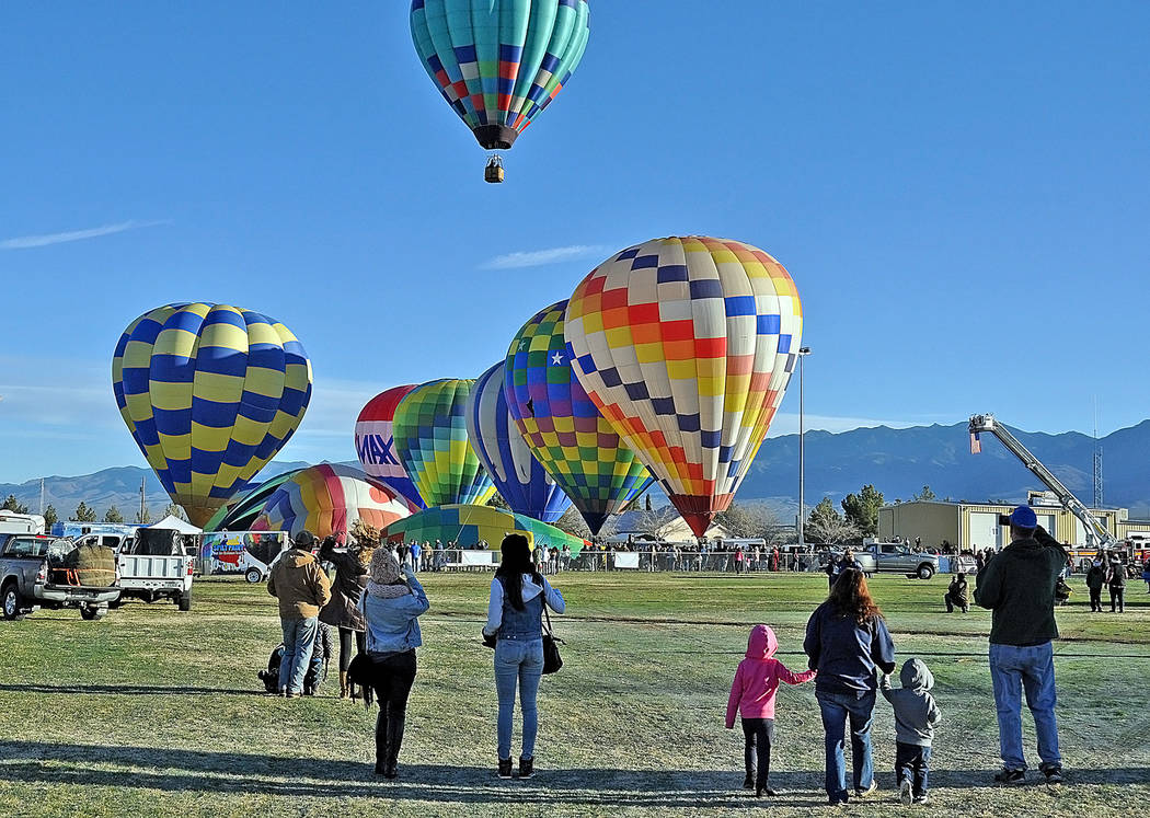 Families and other onlookers pause to watch balloons lift off on Saturday, Feb. 25, day two of the 4th Annual Pahrump Balloon Festival.  Horace Langford Jr. / Pahrump Valley Times