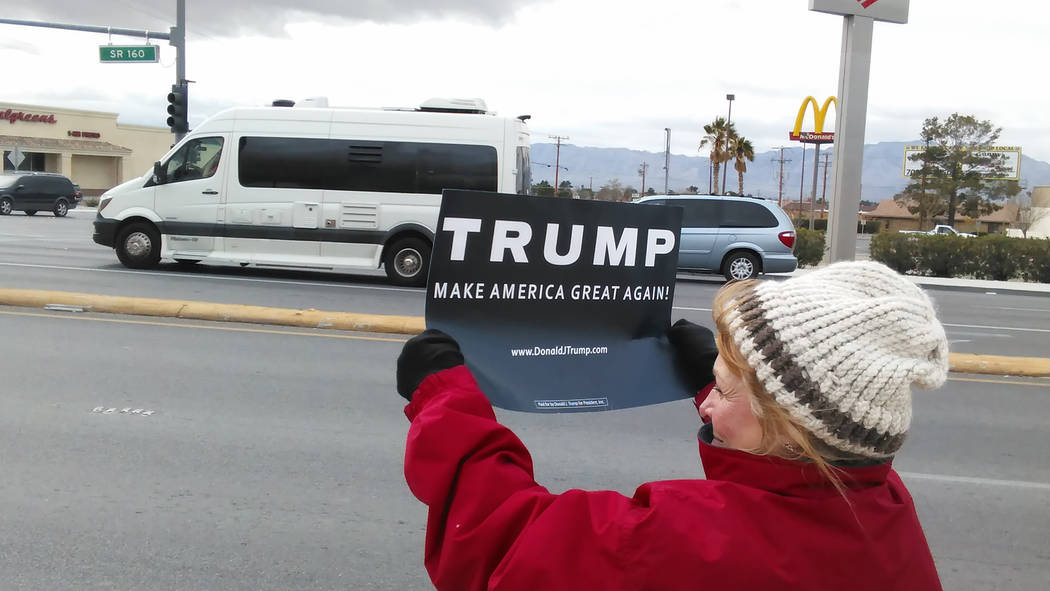 A supporter of President Donald Trump waves a sign on Monday on Highway 160.  Selwyn Harris/Pahrump Valley Times
