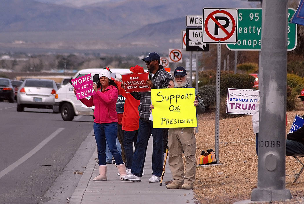 Donald Trump supporters get together to show support for the president on Highway 160 on Monday.  Horace Langford Jr. / Pahrump Valley Times