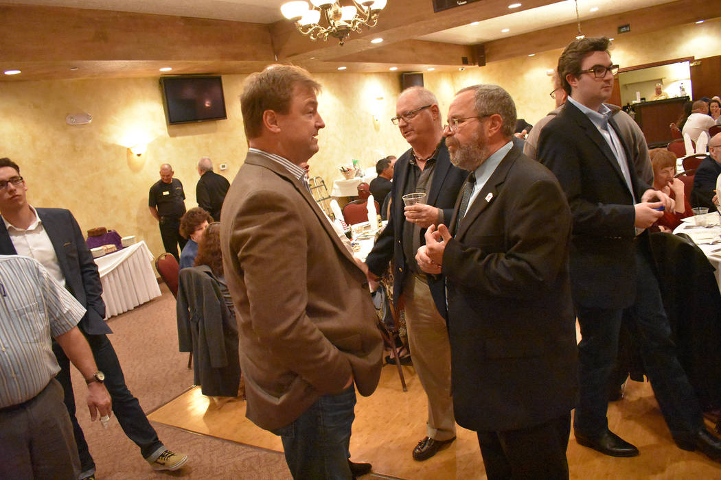 U.S. Sen. Dean Heller talks with Nye County Commissioner Dan Schinhofen during the annual Nye County Republican Lincoln Day Dinner on Saturday. Daria Sokolova/Pahrump Valley Times