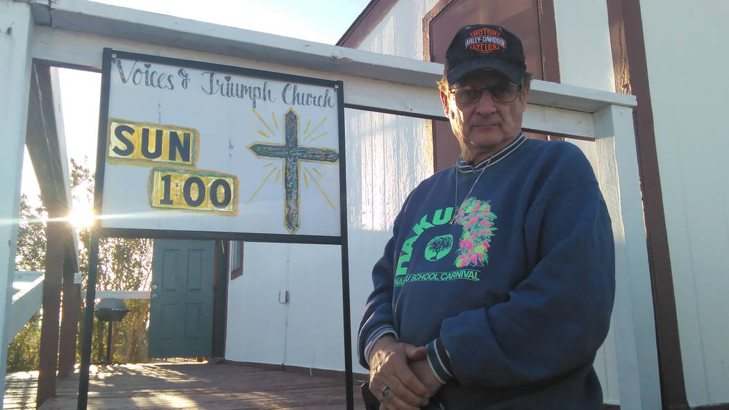 Pastor Arthur Charette stands in front of the Voices of Triumph Church on Emery Street. The church currently has approximately 25 members. Some of the reported vandalism that the owner said was le ...
