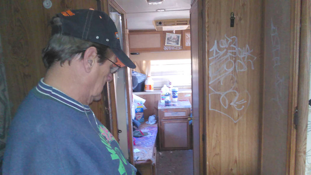 Pastor Arthur Charette inspects the motorhome he allowed several homeless individuals to use for shelter from the cold. The pastor is puzzled as to why the individuals would vandalize their tempor ...