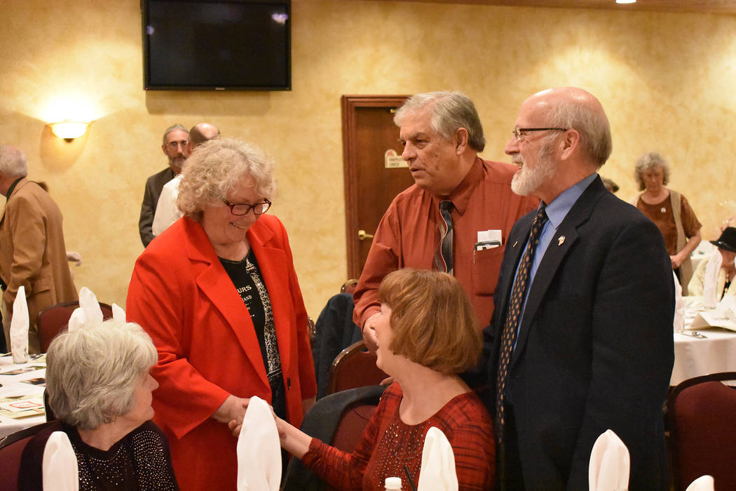 Nye County Sheriff Sharon Wehrly, left, talks with fellow Republicans on Saturday. The Republican Lincoln Day Dinner is an annual event that is organized by the Pahrump Valley Republican Women and ...
