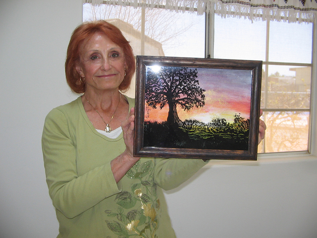Pahrump artist Cheryl Tocco displays one of her reverse glass paintings. She teaches the ancient art form as part of the Art 4 Seniors program sponsored by RSVP (Retired and Senior Volunteer Progr ...